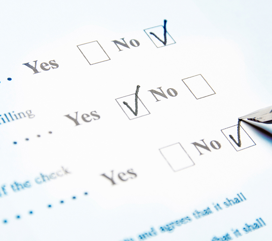 Person filling out questionnaire.